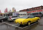 Auto loovutus Esso tanklas Helsinkis.